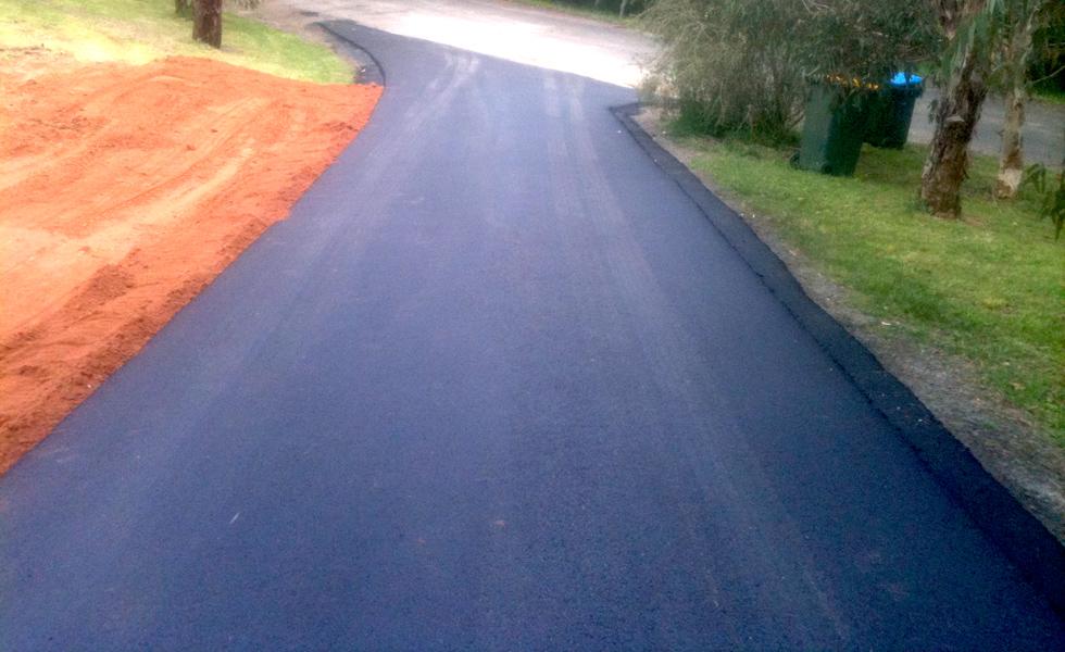 Newly laid small asphalt driveway