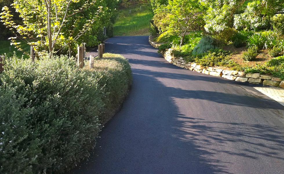 Winding asphalt driveway in Adelaide Hills